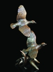 Bronze sculpture of a pair of partridges in flight