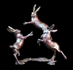 Bronze sculpture of three Hares playing