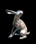 Bronze sculpture of a hare sitting and listening