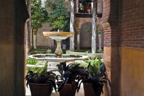 An oil painting of one of the many courtyards set inside the Alhambra Palace in Granada, Spain