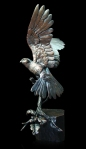 Bronze sculpyure of a Kestrel Landing on a post