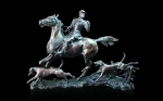 Bronze sculpture of a huntsman out hunting with hounds