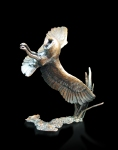 Bronze sculpture of a Barn Owl in flight and about to land