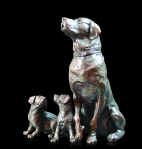 Bronze sculpture of a Labrador siting with two puppies