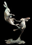 Bronze sculpture of two Hares boxing