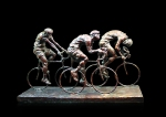 Bronze sculpture of three figure in a cycle race