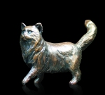 Bronze sculpture of a long haired cat standing