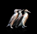 Bronze sculpture of three penguins walking in a row