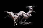 Bronze sculpture of three Hares racing each other