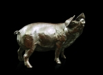 Bronze sculpture of a pig with it's snout in the air