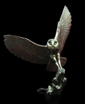 Bronze study of a Barn Owl about to land on a rock