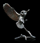 Bronze sculpture of a Barn Owl in flight about to land