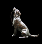 Bronze sculpture of a sitting Labrador looking up with a lead in it's mouth
