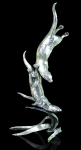 Stainless steal sculpture of two otters swimming