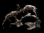 Bronze sculpture of two rutting stags