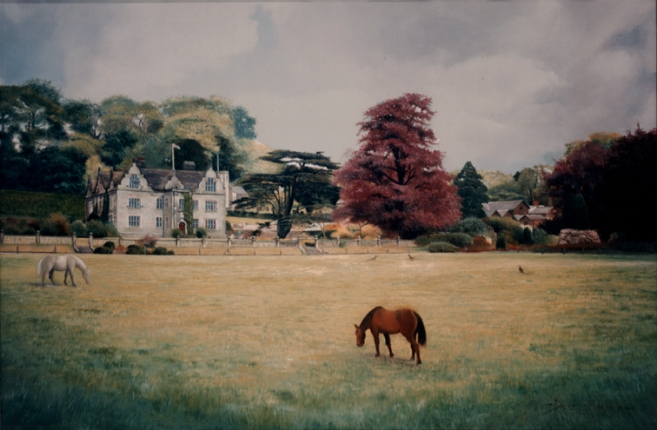 An oil painting of an English country house with a view of the stable block to the right hand side and a Chestnut and Palomino horse grazing in the forground